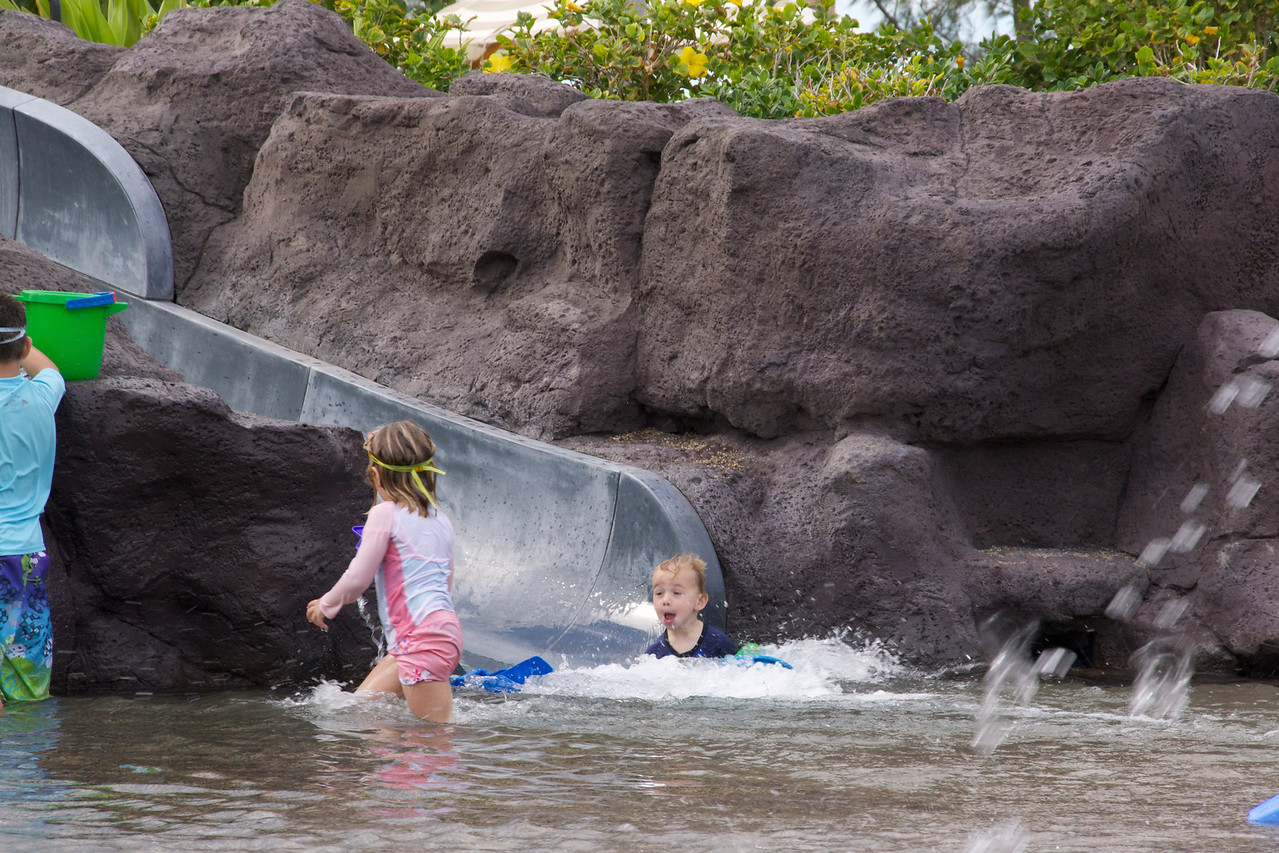 Claire then Luc down the water slide