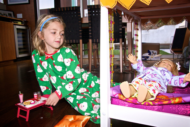 Claire admiring her doll on its new bed (with breakfast in bed tray