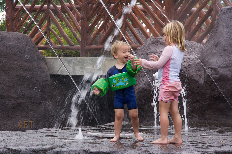 Luc and Claire playing in water feature