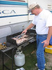 dennis cooking some awesom sausage and bacon