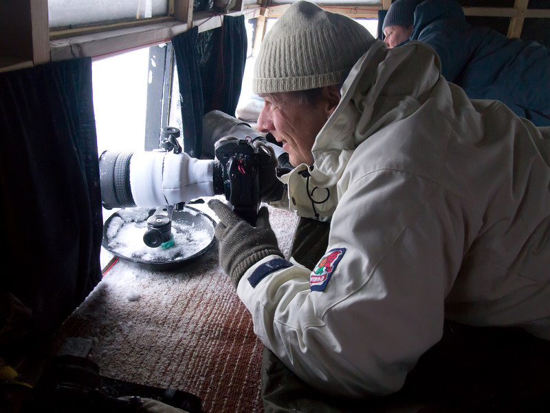 Myself (and Brutus Östling in the background) in the floating hide in Båtsfjord, Varanger peneinsula, Norway, March 2013. Photo taken by Cathrine S. Spikkerud.