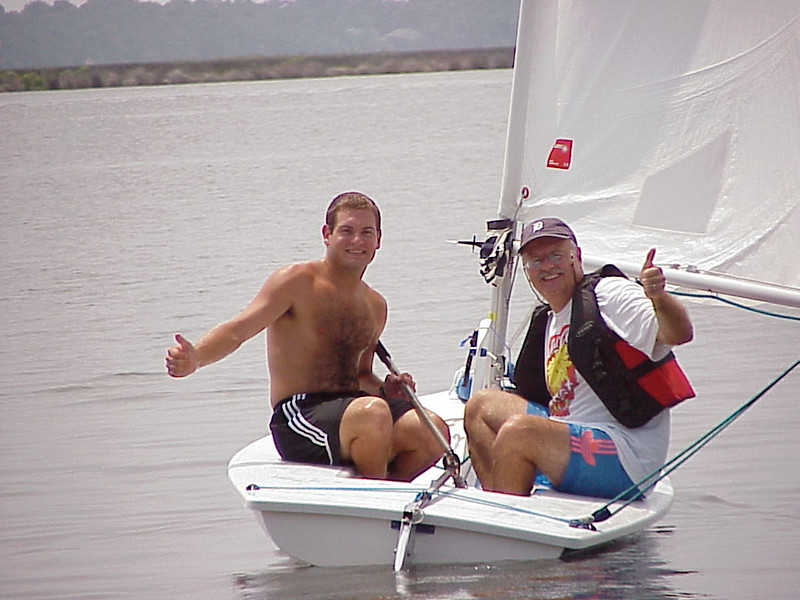 7/27/2002 Big Chill Beach Vacation Jon Deutsch and Bill Merrill sailing on the Laser.