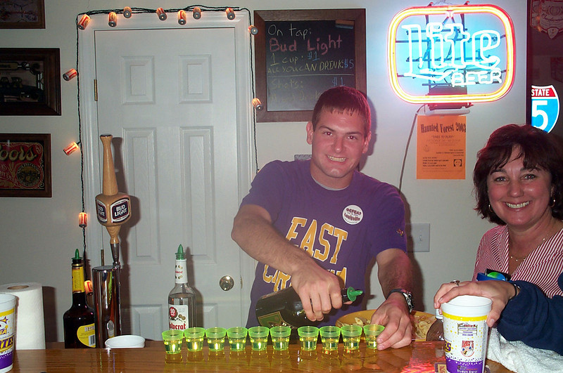 10/25/2003 Jon Deutsch lining up shots at the bar.