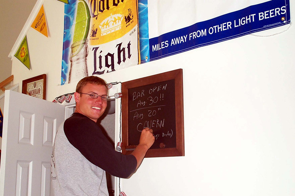 8/20/2003 JG Ferguson writing on the bar chalk board.