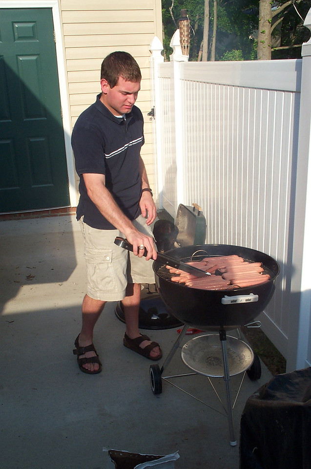 5/7/2004 - Graduation Weekend - Jon Deutsch grilling hot dogs.