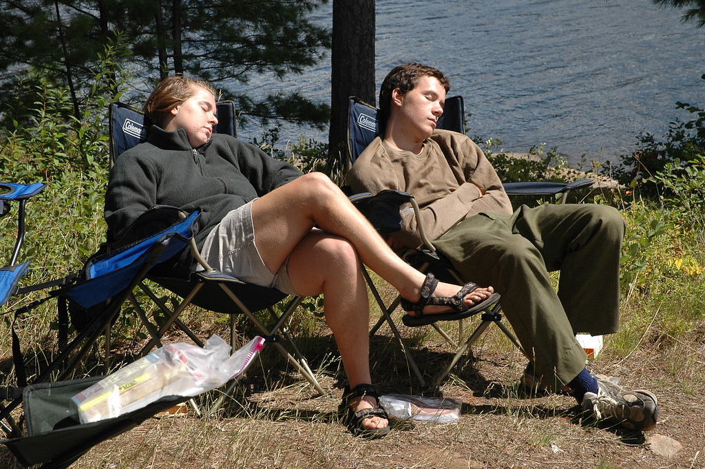 Cheryl and Zack dozing off after a long canoe trip to the campsite.