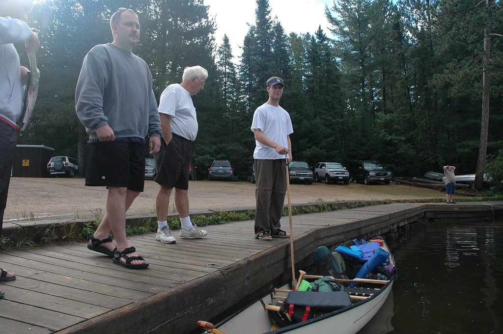 Todd, Mr. Wilson and Scott loading up the canoes.