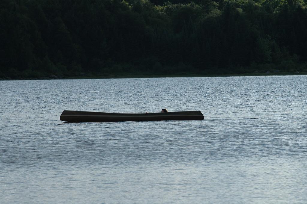 Scott snoozing in the canoe.