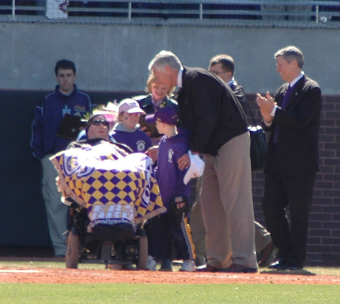 Keith LeClair along with his wife and kids being honord by Terry Holland and Steve Ballard before the start of the Keith LeClair invitational at East Carolina University.