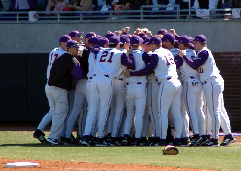 The ECU Baseball team huddled up before their home opener at Clark-LeClair Stadium.