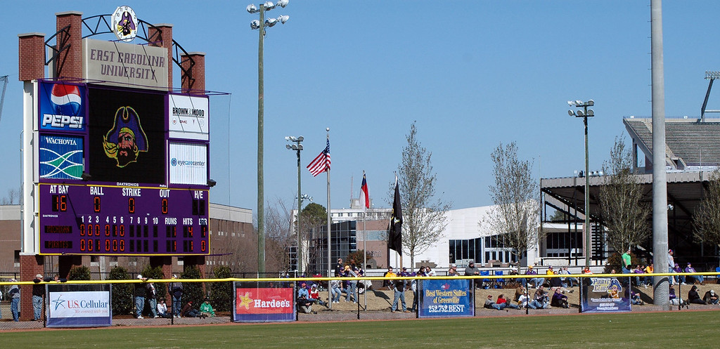 The baseball stadium scoreboard and the jungle in right field.