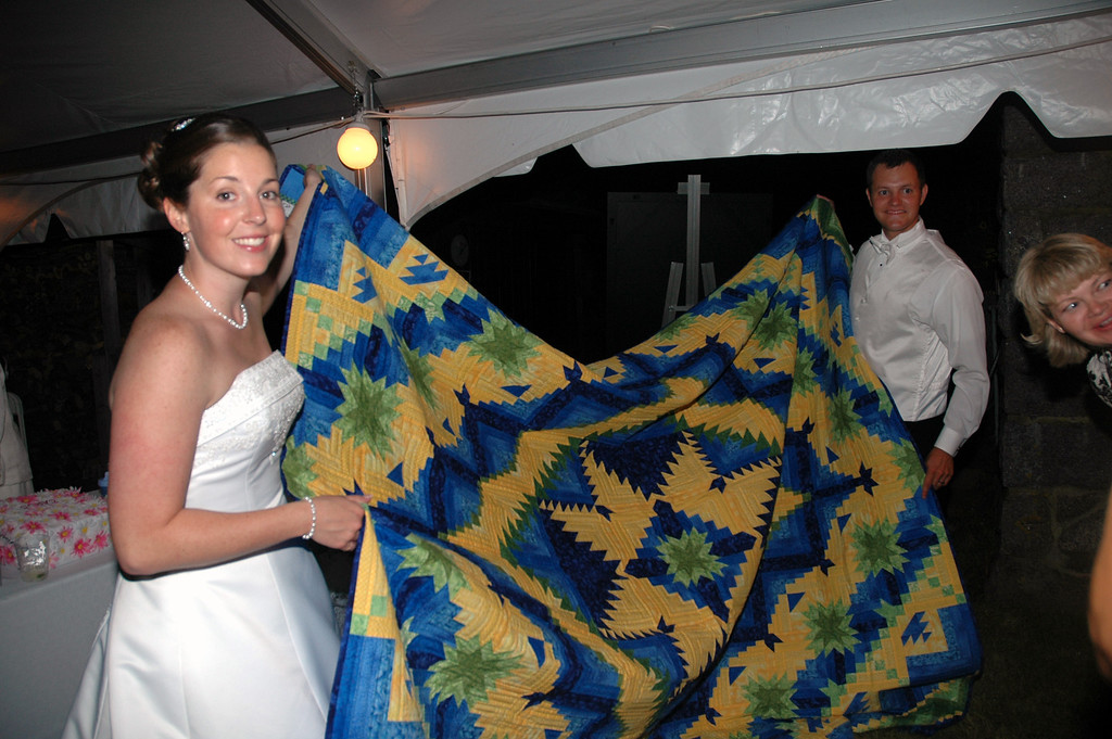 Emily Merrill and Matt Merrill with Melody's wedding quilt.