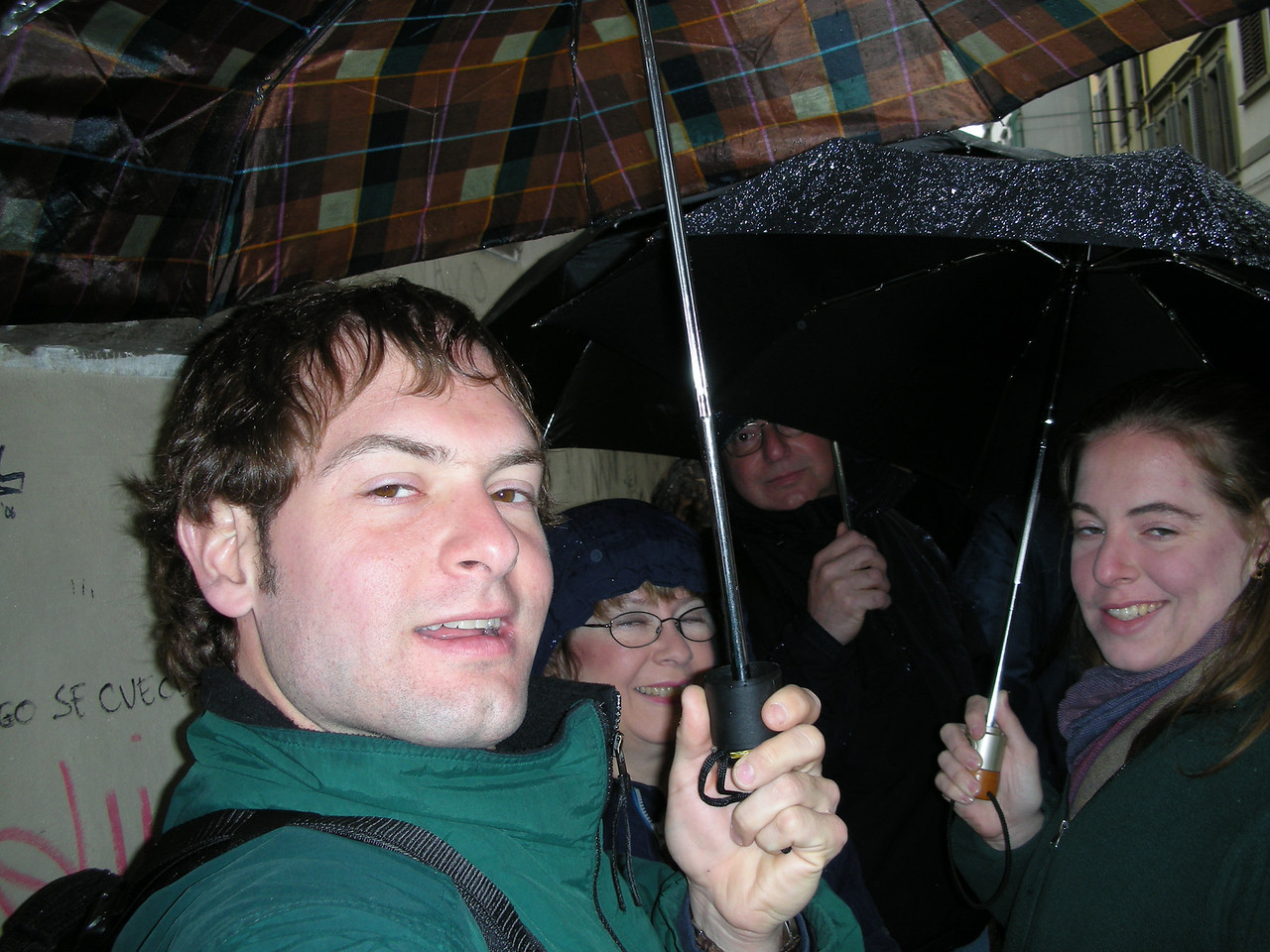 Waiting in line in the rain to see David.  Jon Deutsch, Pat, Stan and Cheryl.