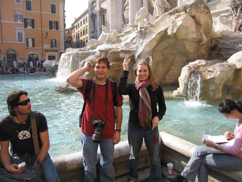 Jon & Cheryl throw rupees into the Trevi Fountain.