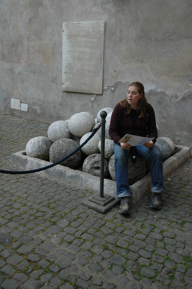 Cheryl sits on some cannon balls in Castel Sant'Angelo.