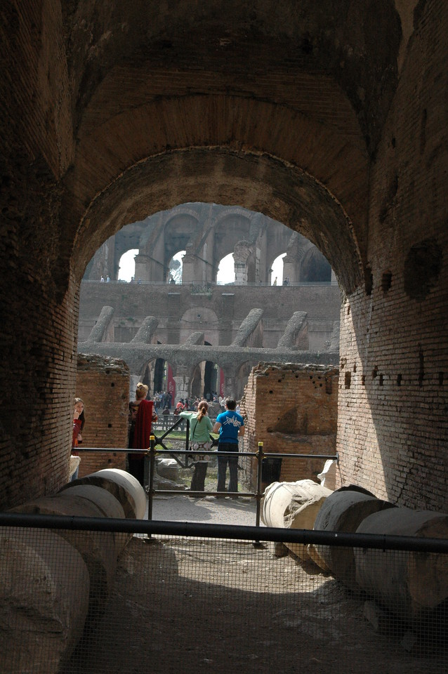 Looking through an archway inside the Coliseum.