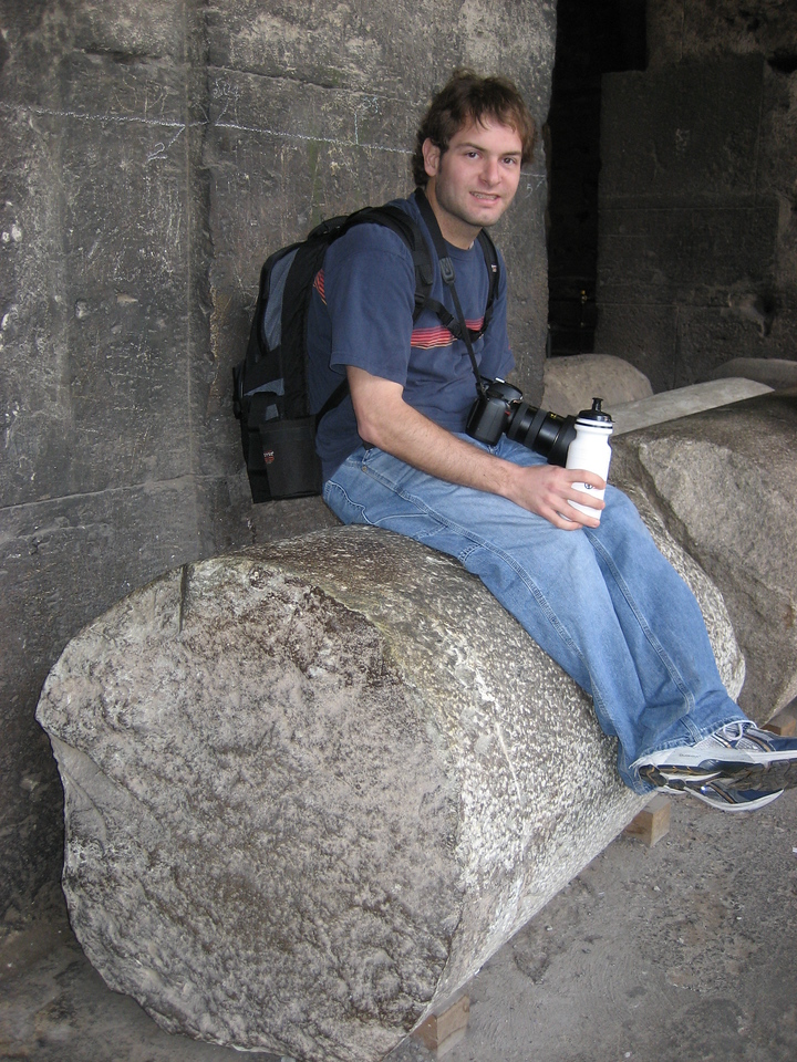 Jon Deutsch sitting on a column inside the Coliseum.