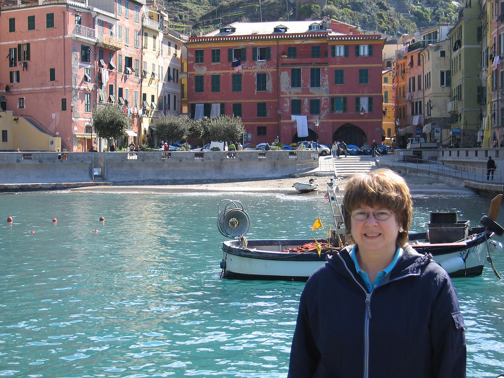 Pat in front of the Vernazza waterfront.  Our rooms were on the upper floors of the red building to the left.