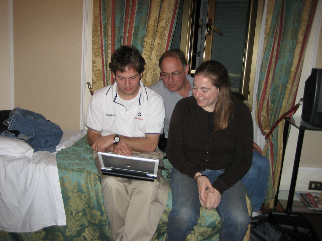 Jon, Stan & Cheryl looking at pictures from the past day.