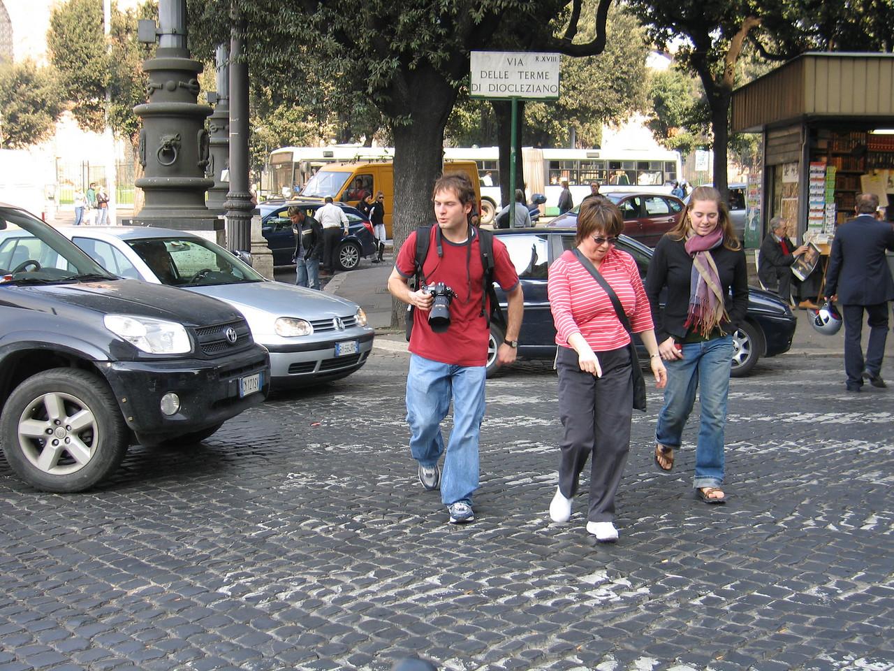 Jon, Pat & Cheryl crossing the street.