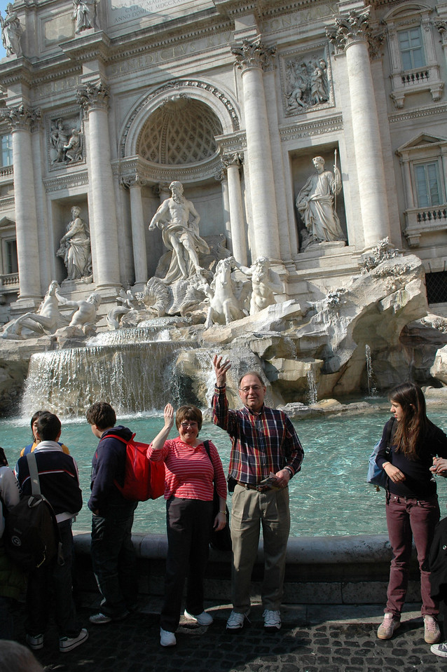 Pat and Stan throw rupees into the Trevi Fountain.