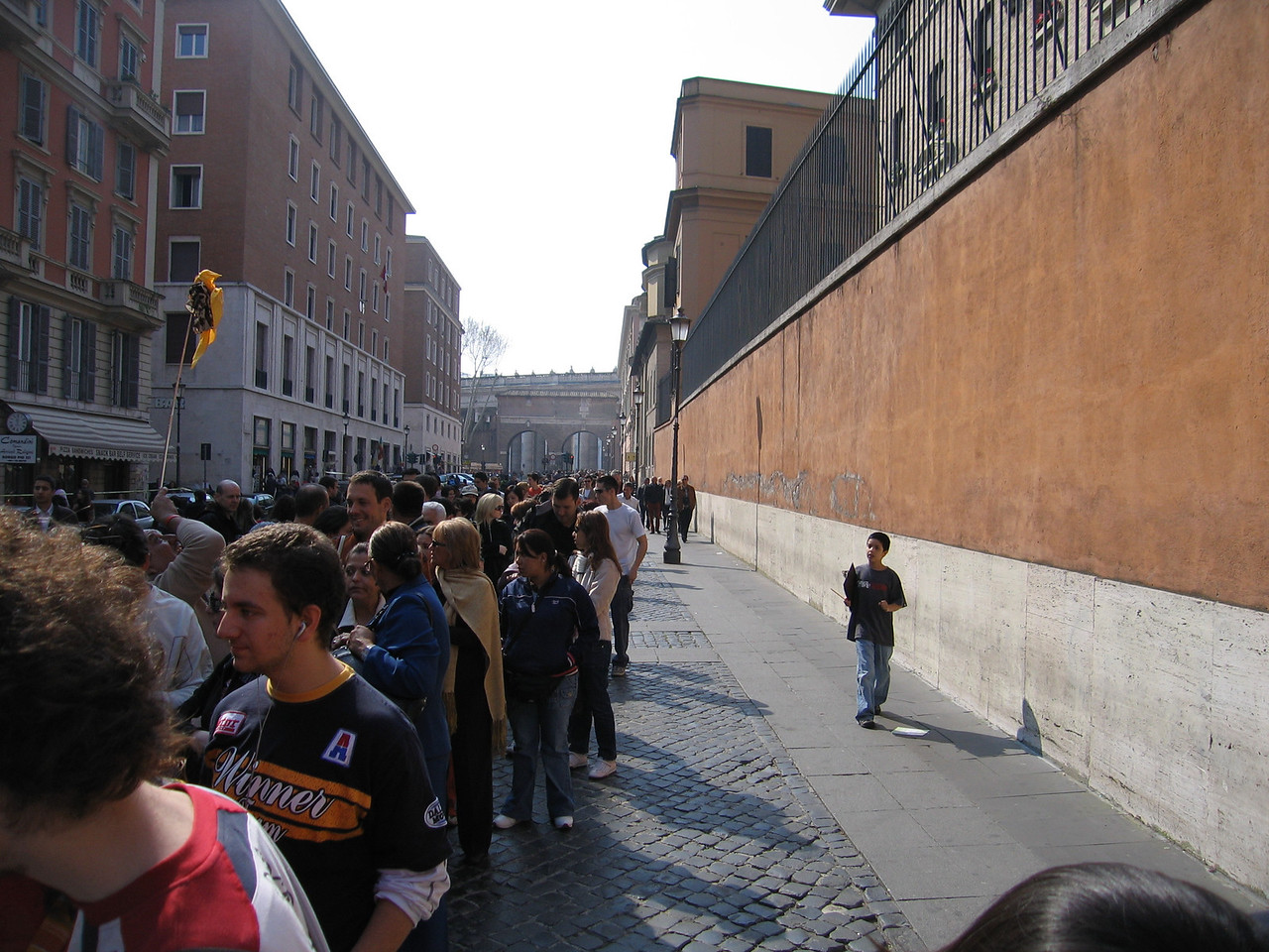 Line for the Vatican Museum stretching all the way around Vatican City to the entrance to St. Peter's Square.