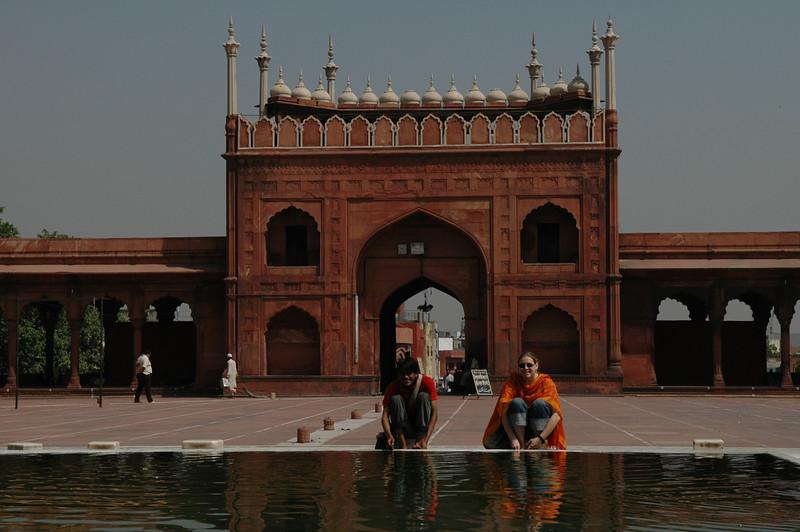 Delhi: Amar and Cheryl washing their feet at Jama Masjid Mosque.