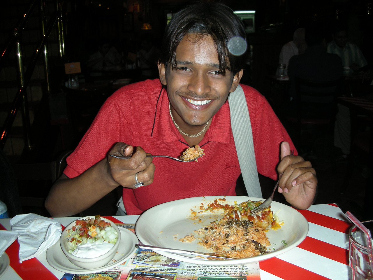 Delhi: Amar eating American food (Mexican really) at TGI Fridays following the previous Indian meal that Cheryl and Jon ate.