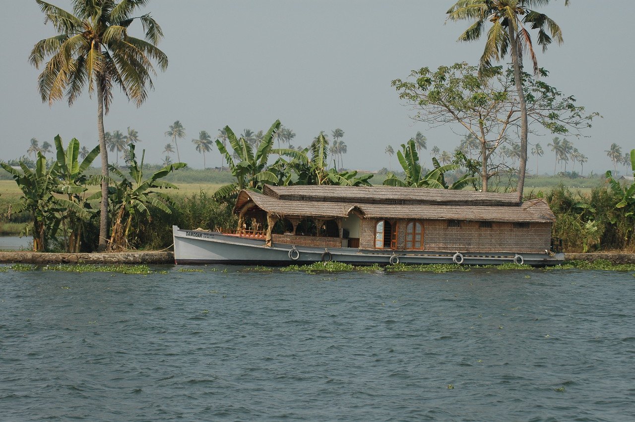 House boat docked along the banks of the backwaters in Kerala