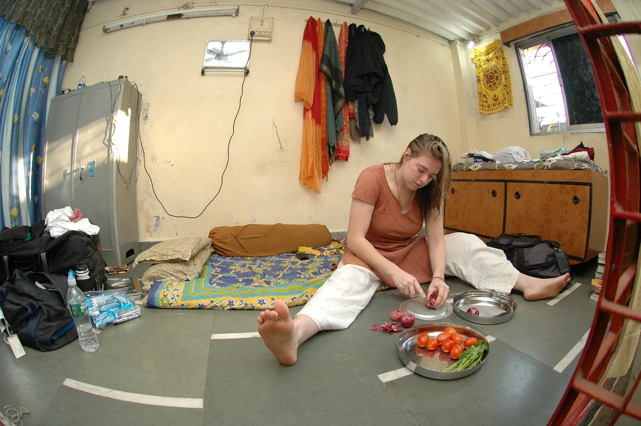 Cheryl preparing food on the 'table' in her apartment.