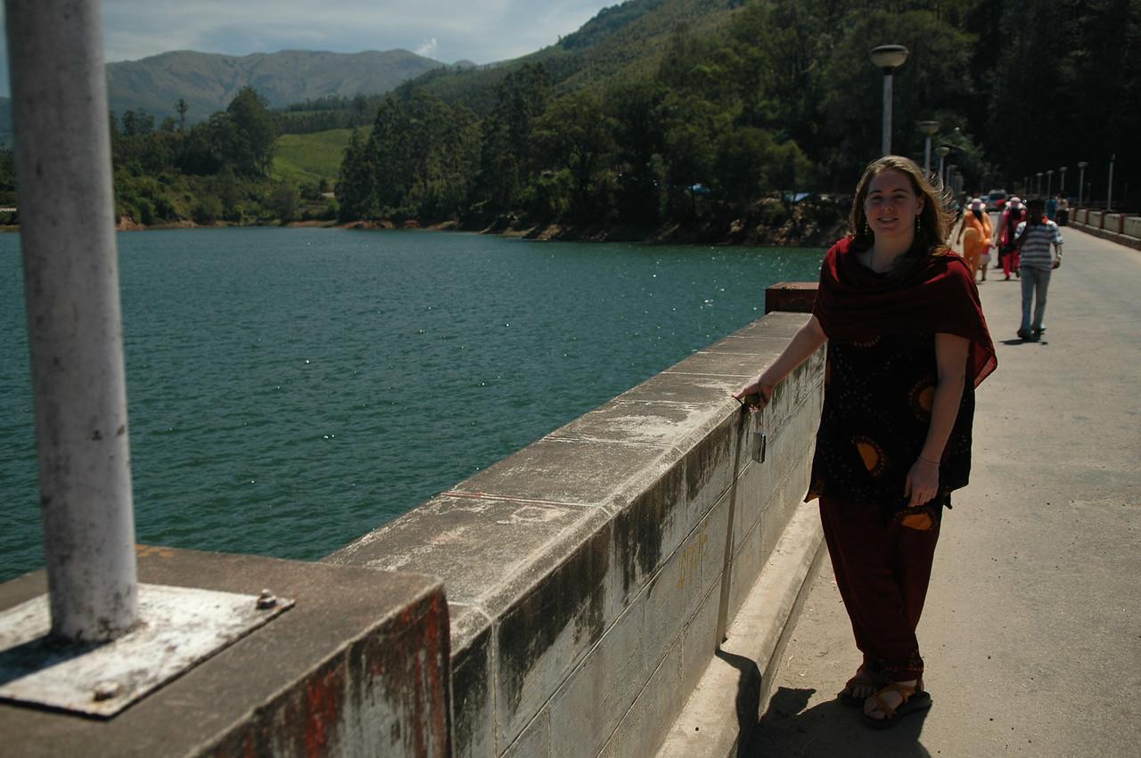 Cheryl on a dam on a lake near Munnar