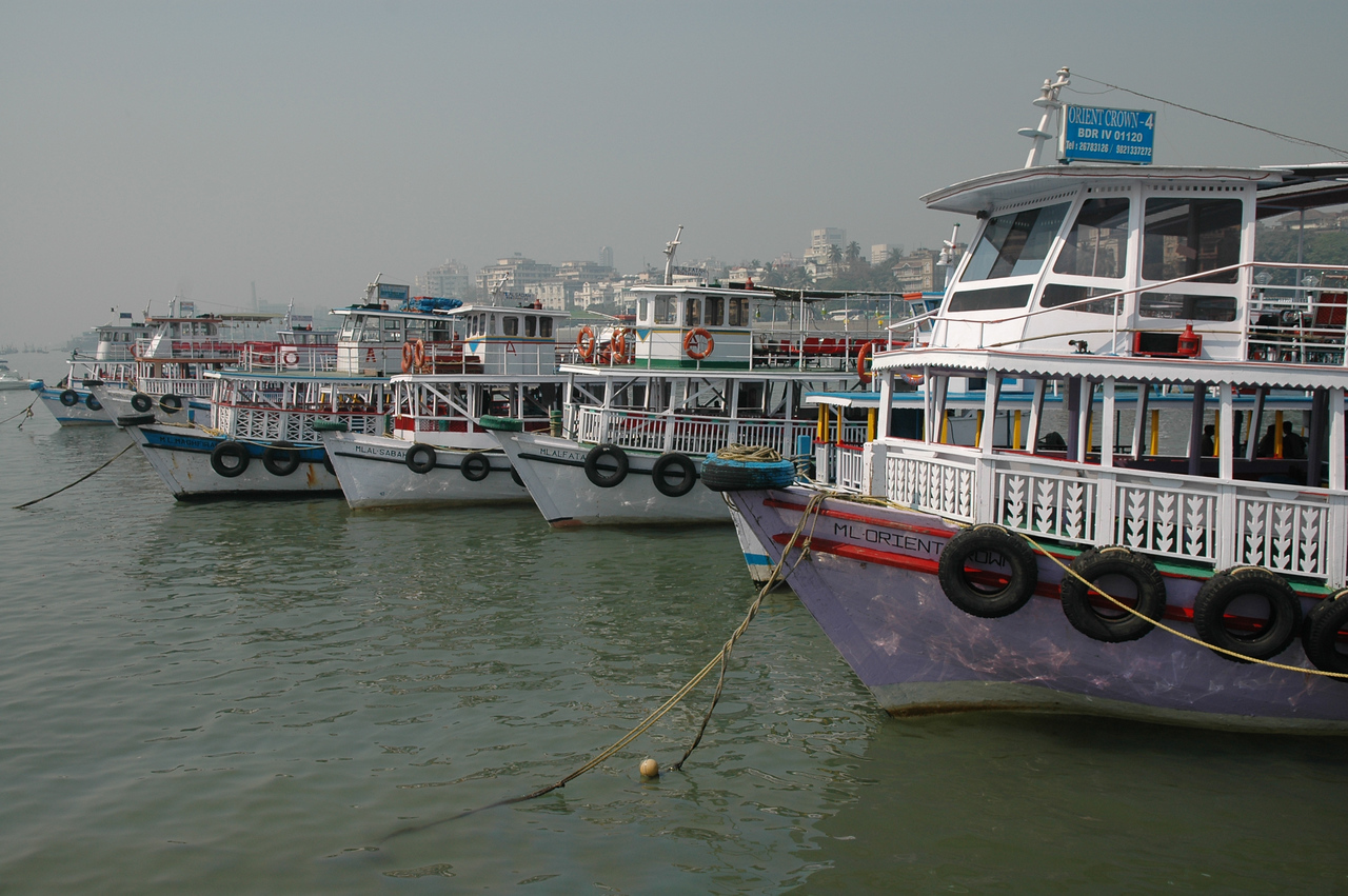 Tour boats anchored in the harbor in Mumbai