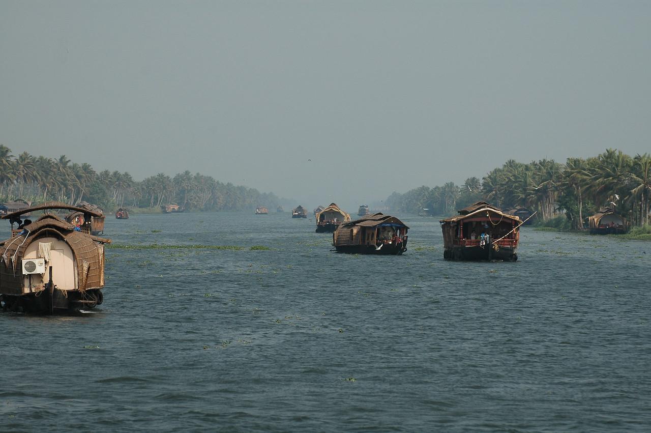 Houseboat traffic on the backwaters of Kerala