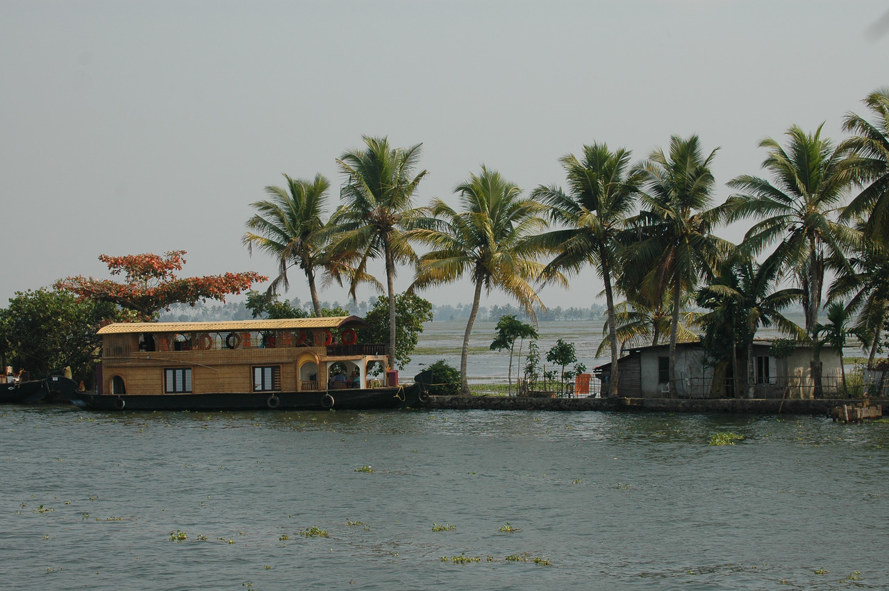 Houseboat docked along the banks of the backwaters in Kerala
