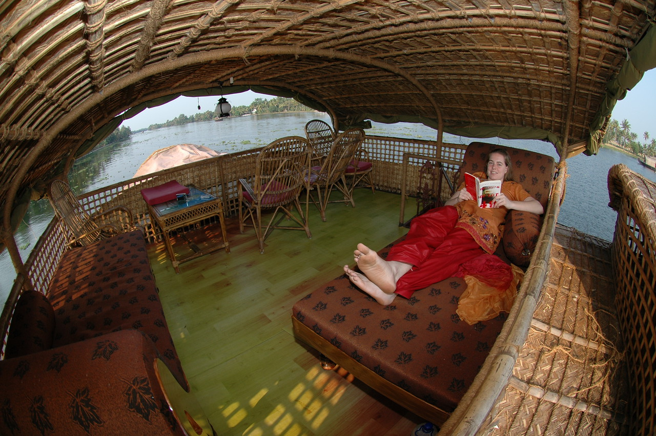 Cheryl reading on the upper deck of our house boat on the backwaters of Kerala