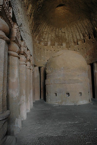 inside a temple at the Kanheri Caves