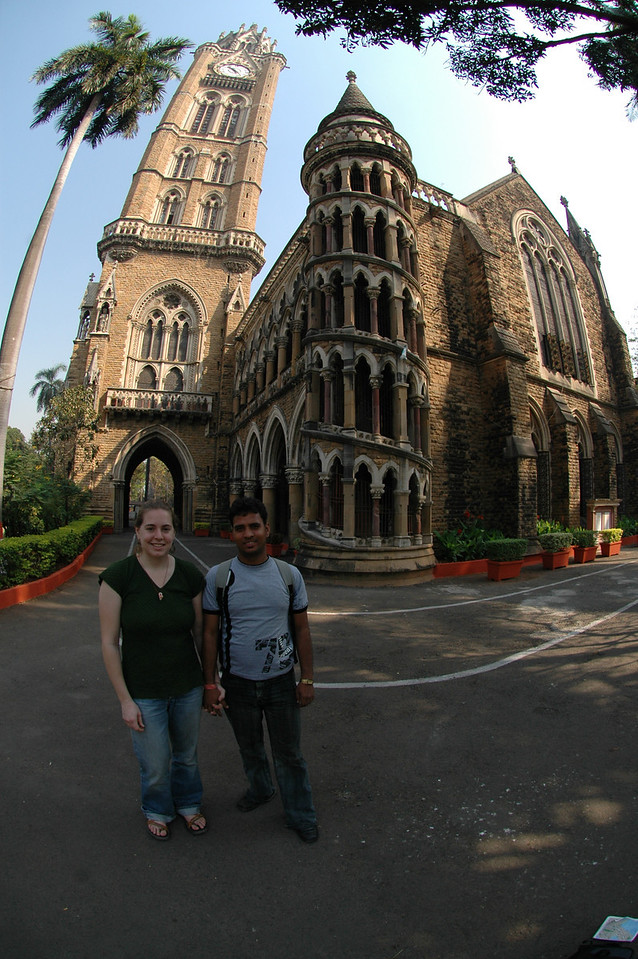 Cheryl and Dilip in front of one of the buildings of Bombay University