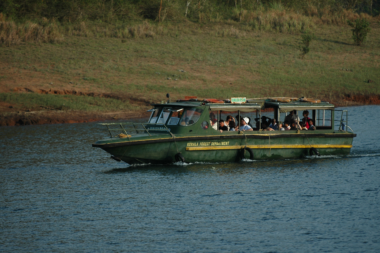 A tourist boat traveling along the lake in the Periyar Wildlife Preserve