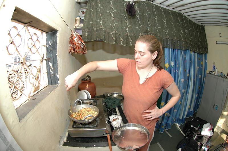 Cheryl preparing food in her apartment.