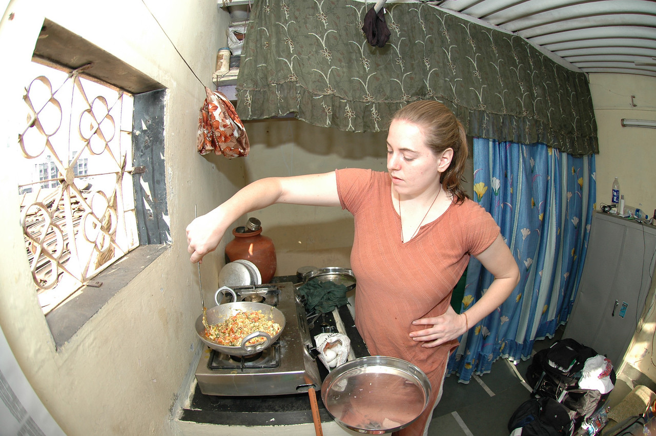 Cheryl preparing food in her apartment.