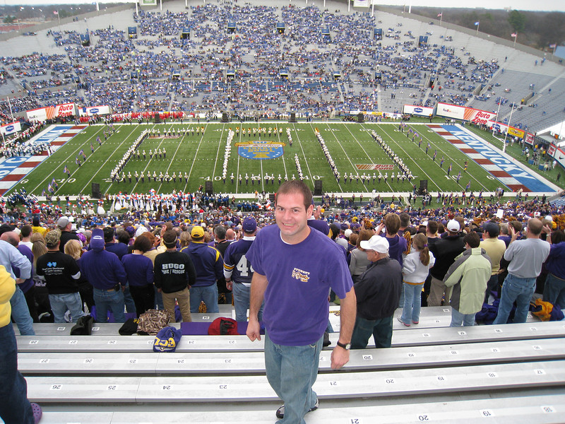 Jon with the ECU Marching band on the field at the Liberty Bowl