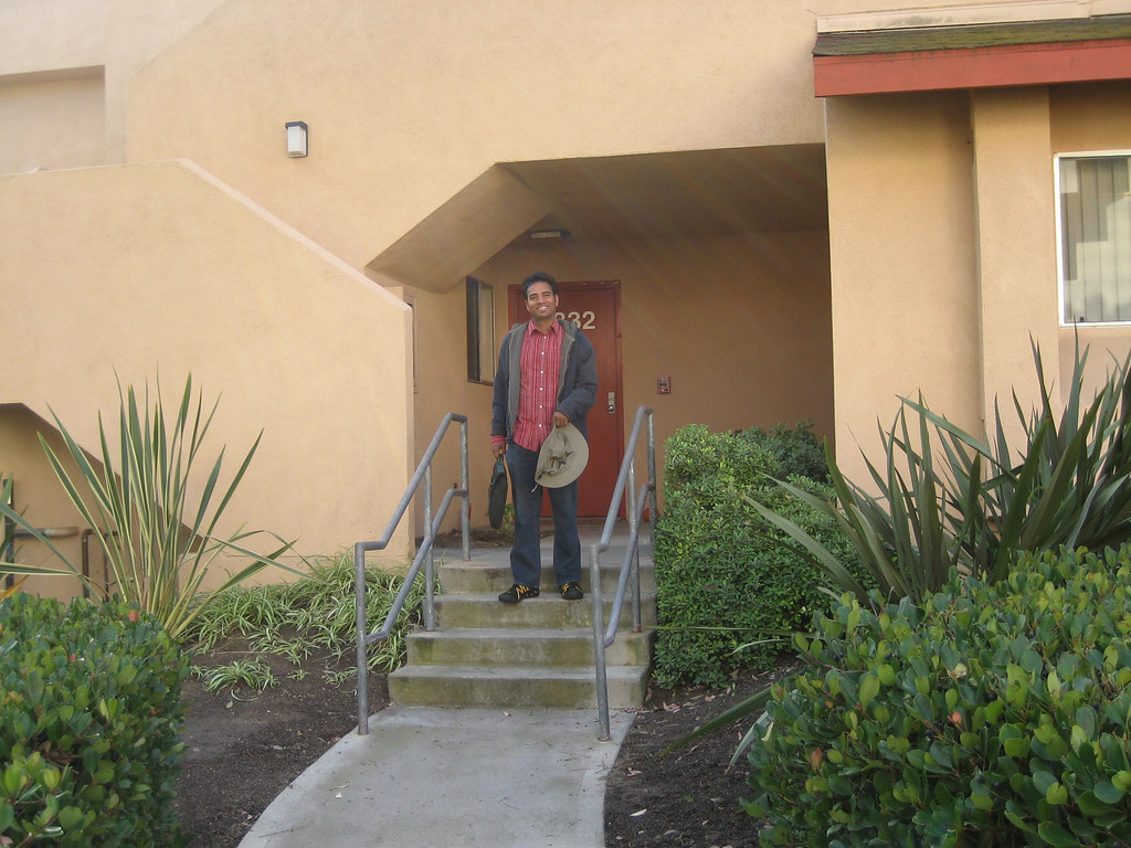 Dilip in front of the apartment.