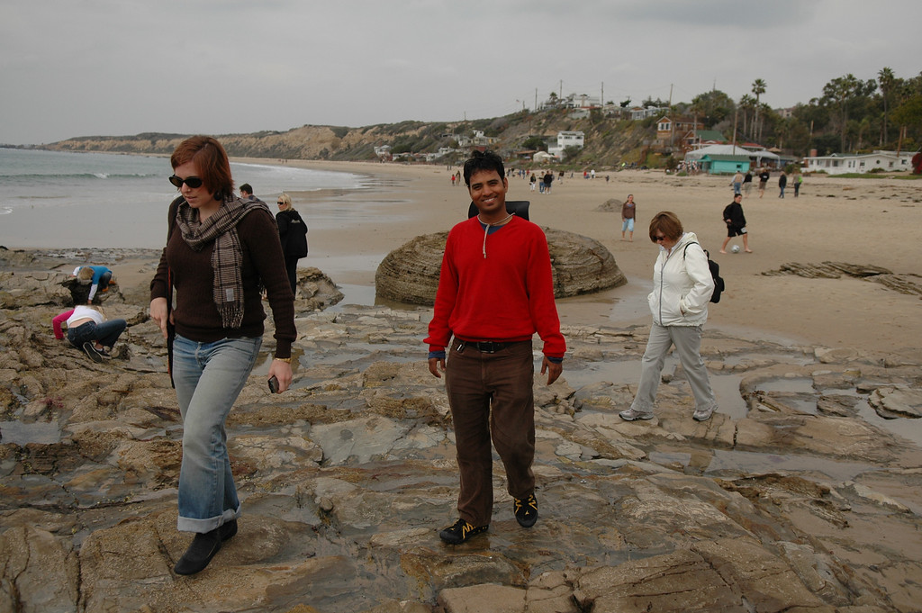 Cheryl, Dilip, Pat walking along Crystal Cove Beach