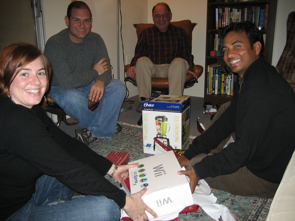 Cheryl, Jon, Stan, Dilip opening presents