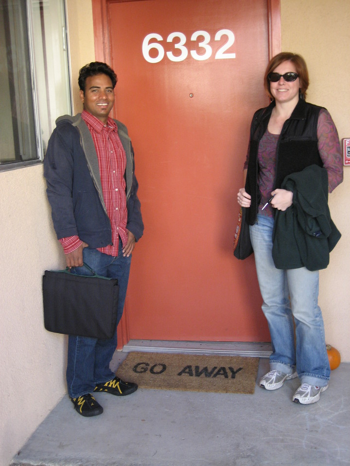 Dilip and Cheryl in front of their apartment.