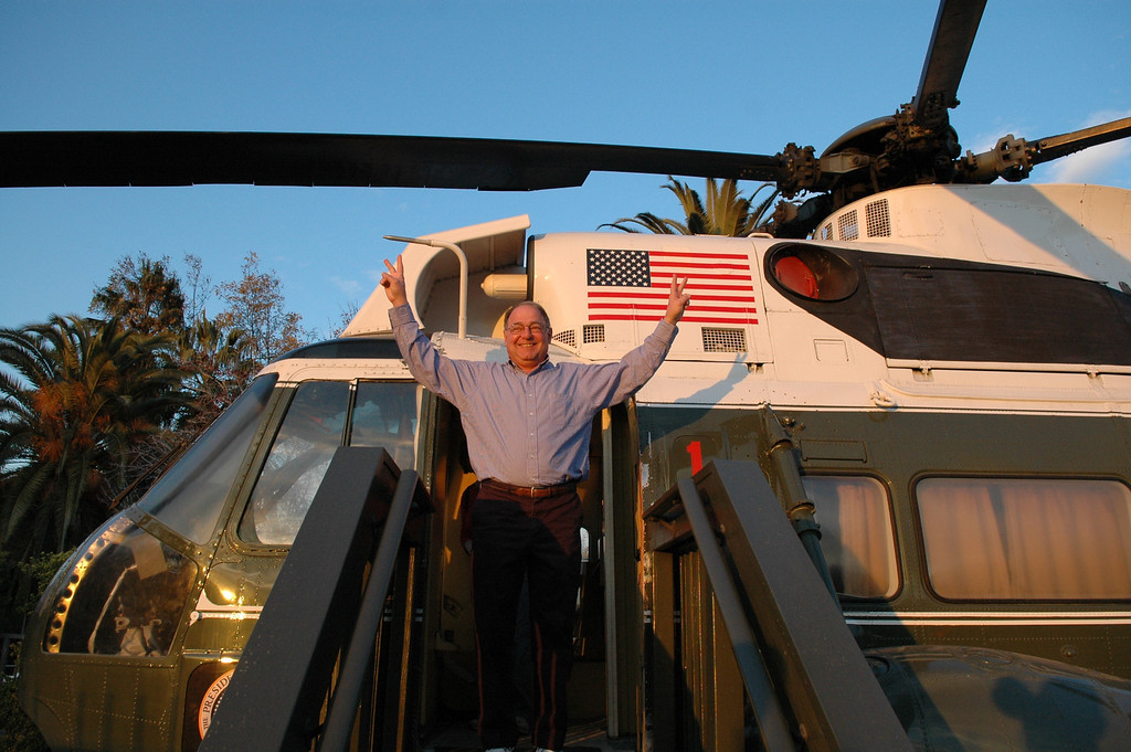 Stan waving the victory sign at the Nixon Presidential Library