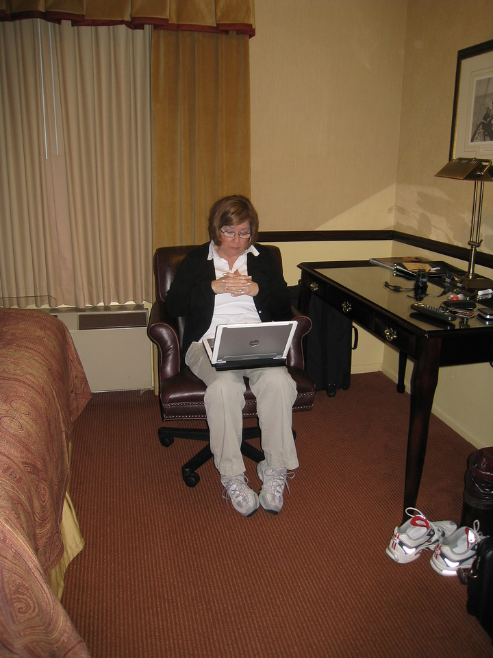Pat looking at pictures in the hotel room.