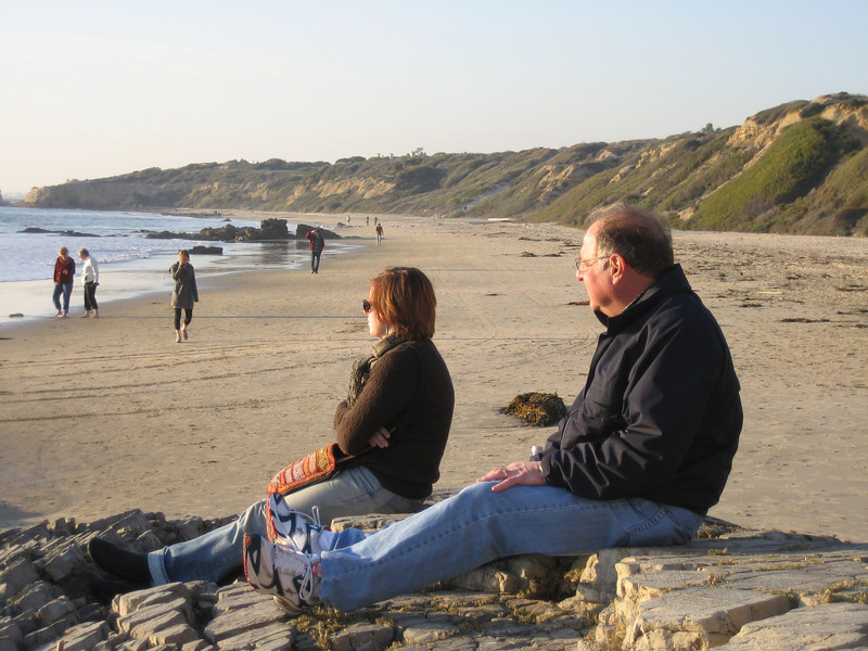 Cheryl and Stan watching the sun set at Crystal Cove State Park