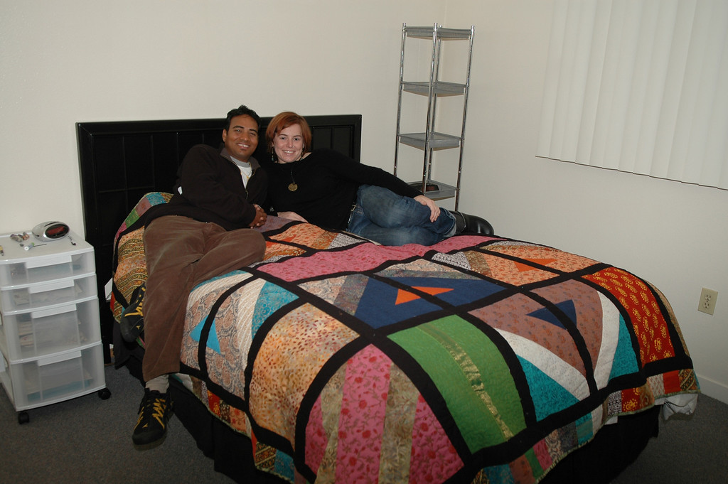 Dilip and Cheryl on their wedding quilt.