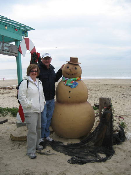 Pat, Stan and a snow man on the beach